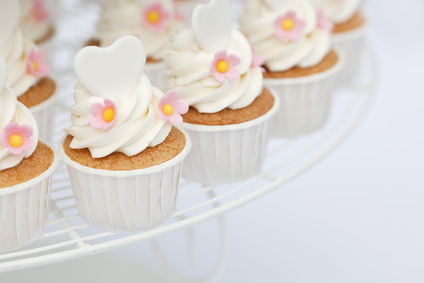 Heart shape decoration on cupcakes with shallow focus